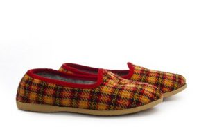 Use a singular verb with a 'pair of' slippers, shoes or trousers.