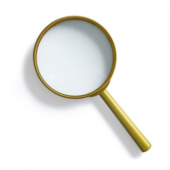 Simple vintage brass magnifying glass isolated with clipping path included